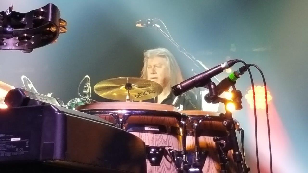 Paul Burgess on drums
